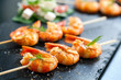 Appetizing grilled prawns on skewer.