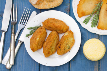 fish croquettes on white plate