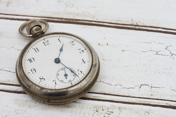 Old pocket watch on wood background