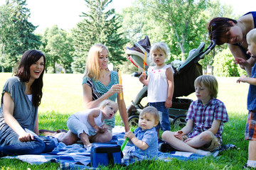 Moms and children at park