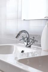 Steel faucet in a bathroom