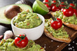Leinwanddruck Bild - Guacamole with bread and avocado