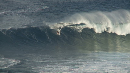 Big Wave Surfers at Jaws, Maui Hawaii - Slow Motion Clip 3 of 5