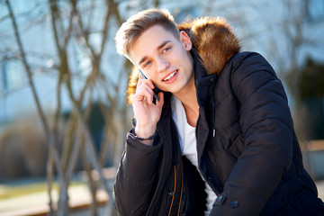 Young man with smartphone outside
