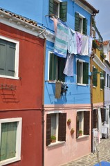 Laundry on blue house in Burano, Venice, Italy