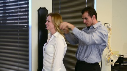A woman receiving a spinal adjustment