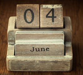 A very old wooden vintage calendar showing the date 4th June on