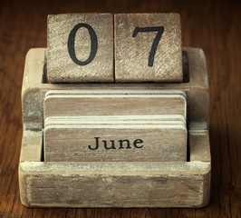 A very old wooden vintage calendar showing the date 7th June on