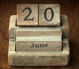 A very old wooden vintage calendar showing the date 20th June on