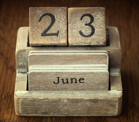 A very old wooden vintage calendar showing the date 23rd June on
