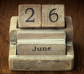 A very old wooden vintage calendar showing the date 26th June on