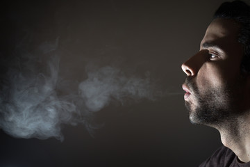 Profile of a person smoking