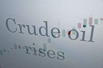 "Inscription ""Crude oil rises"" on PC screen. Business concept."