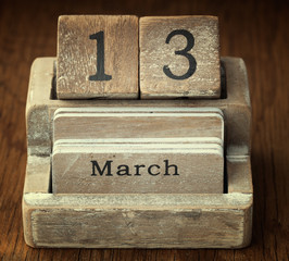 A very old wooden vintage calendar showing the date 13th March o