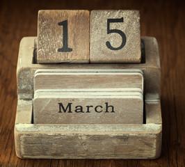 A very old wooden vintage calendar showing the date 15th March o