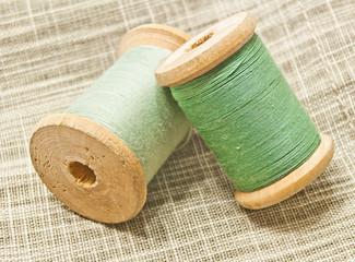 wooden spools of green thread