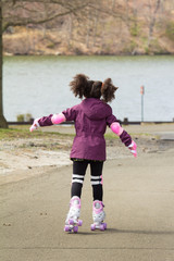 Young girl on rollerskates