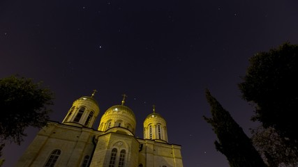 Orthodox church at night with lots of stars. 4K time lapse.