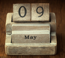 A very old wooden vintage calendar showing the date 9th May on w