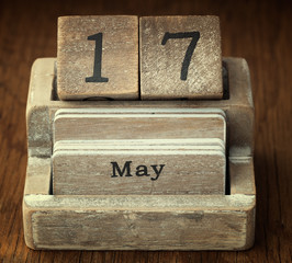 A very old wooden vintage calendar showing the date 17th May on