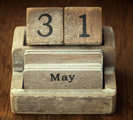 A very old wooden vintage calendar showing the date 31st May on