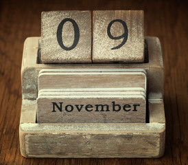 A very old wooden vintage calendar showing the date of 9th Novem