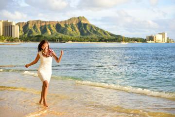 Hawaii woman having fun on Waikiki beach, Honolulu