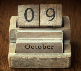 A very old wooden vintage calendar showing the date of 9th Octob