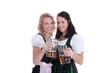Freundinnen im Dirndl mit Bierkrug haben Spaß