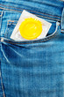 Condom in a jeans pocket. - 78856842