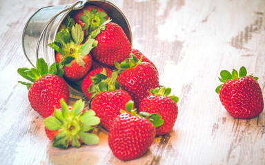 Spring fruits, strawberries with strawberry yogurt on a vintage