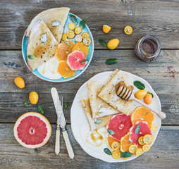 Spring vitamin breakfast set. Thin crepes or pancakes
