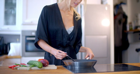 Pretty blond woman making the dinner