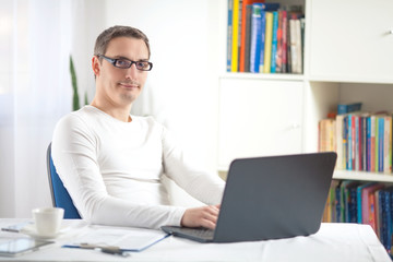 Portrait of young businessman working at home