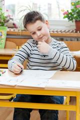 Preschool boy doing enrollment to school