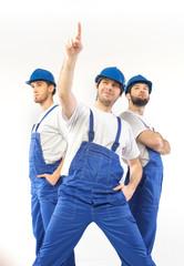 Portrait of three handsome builders