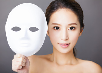 young woman holding white mask for medical beauty concept