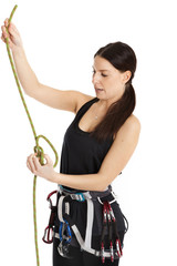 A girl rock climber makes the safety knot. Isolated on white