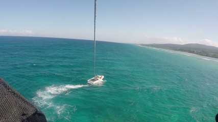 Para sailing water sport flying over ocean view from the sky
