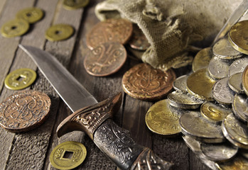 Decorated dagger with ancient coins