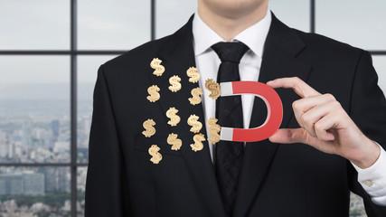 businessman attracts dollar symbol