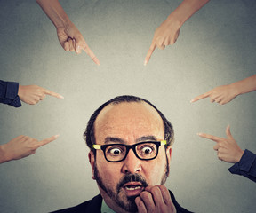 Concept social accusation guilty businessman fingers pointing