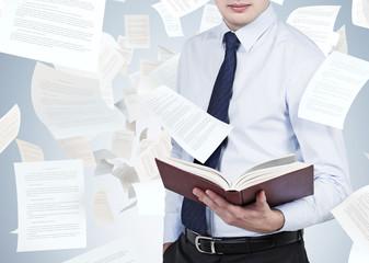 businessman holding book