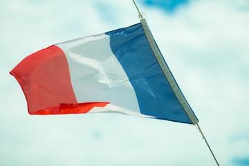 Full flag of France blue sky background