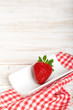 Single red strawberry