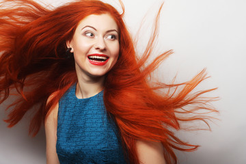 happy woman with long flowing red hair