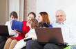 family enjoys few laptops at home