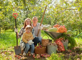 Happy parents and child   in garden