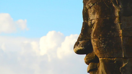 Zoom Out of Stone Carving of Buddha's Face on Temple Wall - Angkor Wat Temple Cambodia