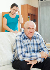 Unhappy mature man with sad wife